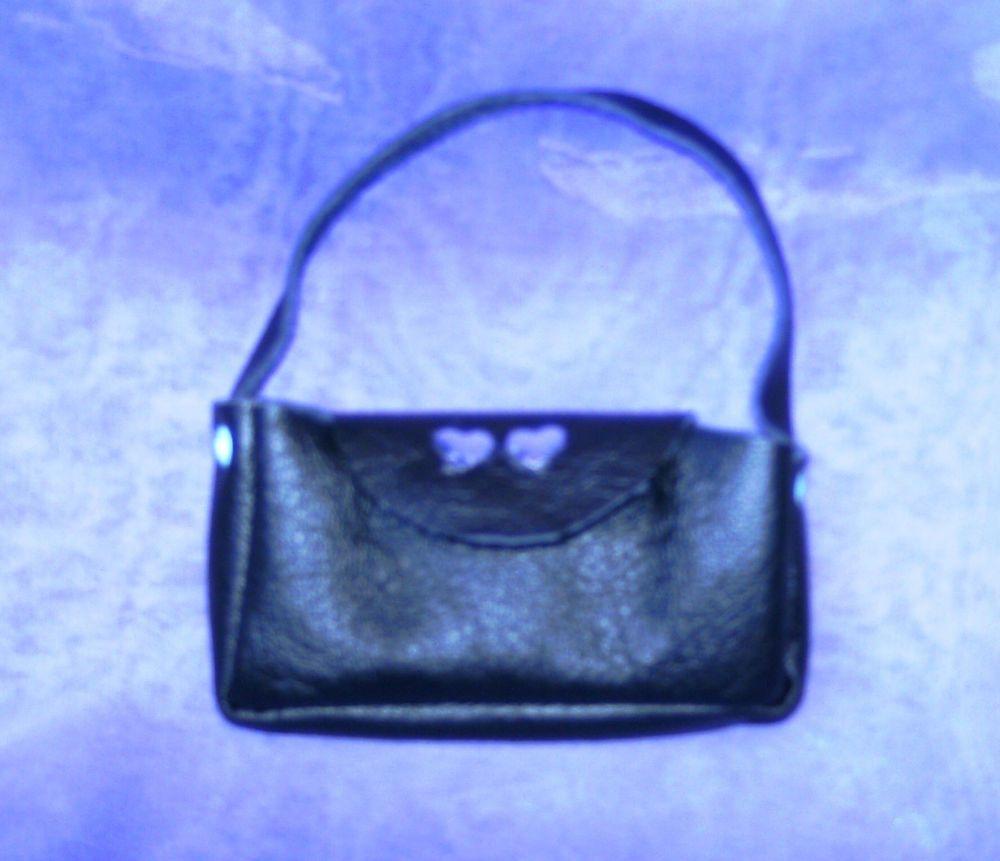 Doll's handbag in black vinyl