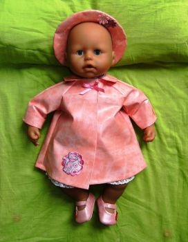 Doll's raincoat and sou'wester hat