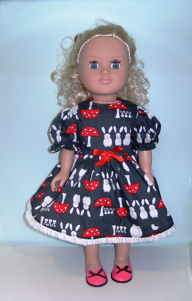 Doll's dress and hair ribbon