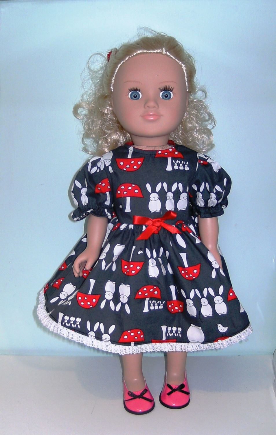 Doll's dress and hair ribbon