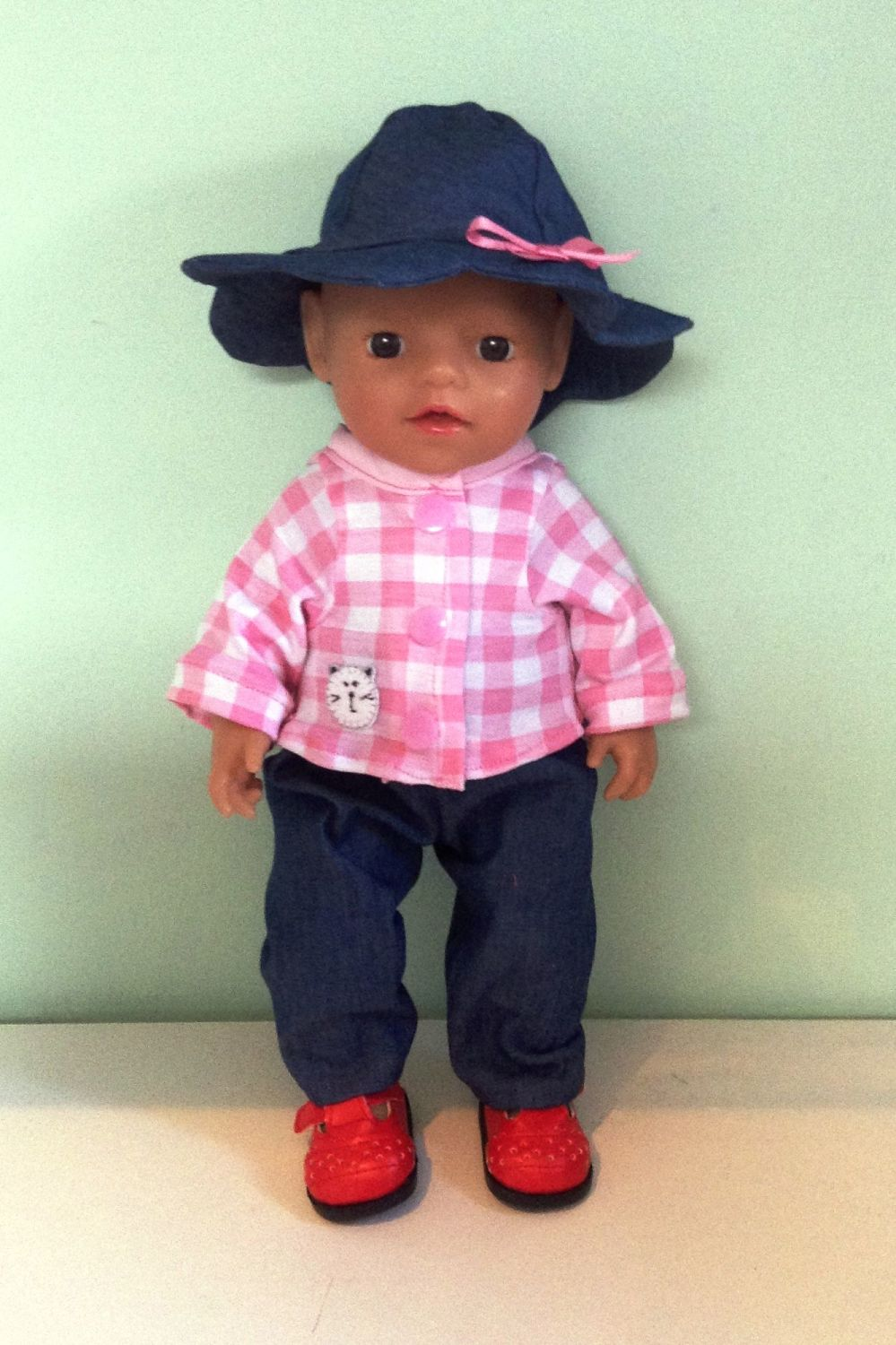 Doll's jeans , jacket and hat made to fit a 12 inch high baby girl doll