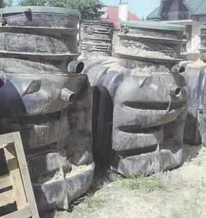 Bent plastic sewage treatment tank