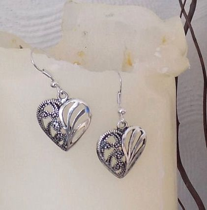 One pair of Antique Style Heart earrings in a Silver Shade