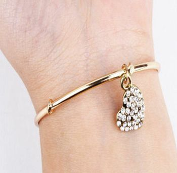 Gold shade solid bracelet with rhinestone pendant heart