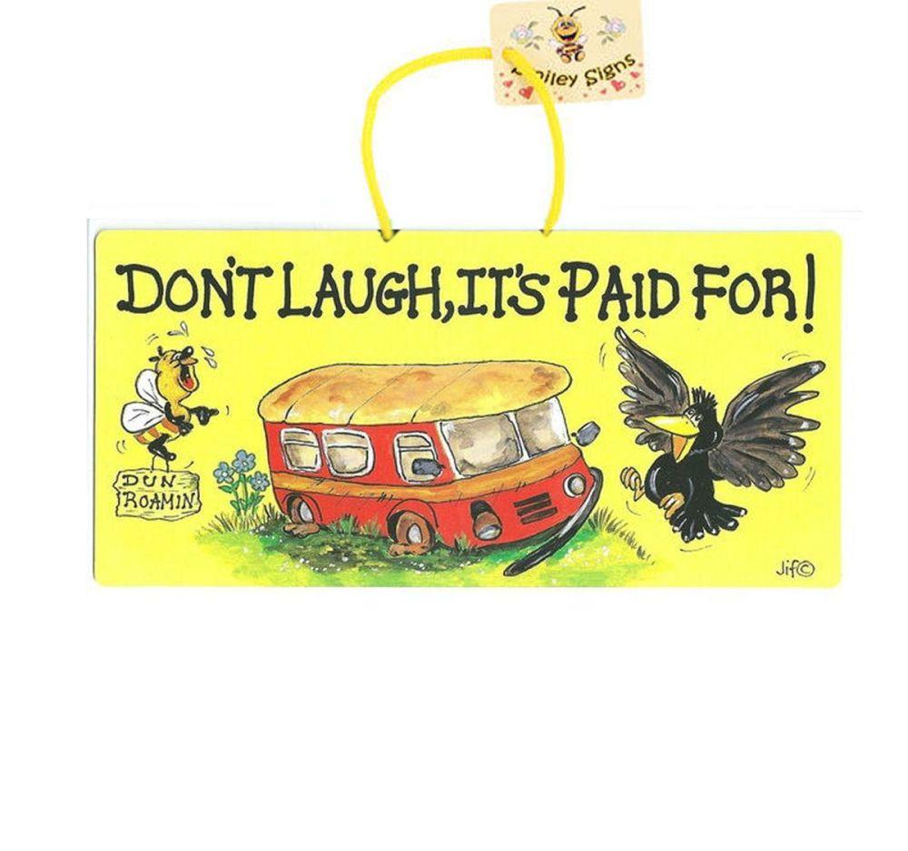 Caravan sign that states Don't laugh it's paid for