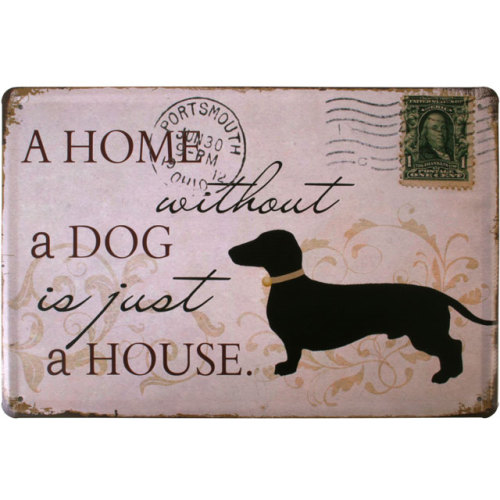 A metal shabby chic wall plaque in a dog design.