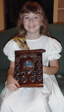 Jo in National Dress with her trophy from Applecroft