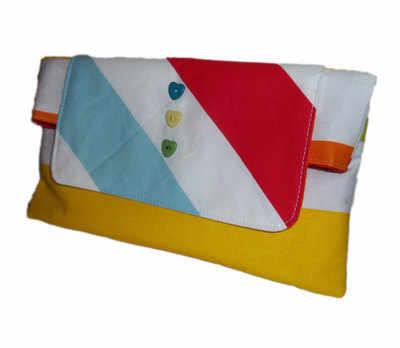 Sunny days multi stripe clutch bag