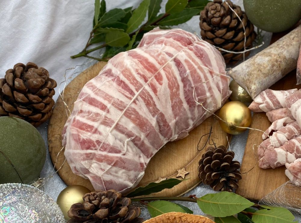 Hand rolled turkey breast topped with dry cured streaky bacon