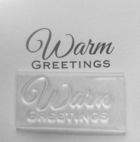Warm Greetings script stamp