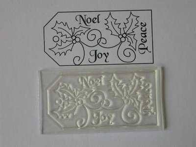 A Christmas tag stamp with holly 6x3cm