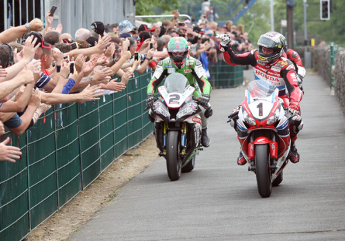 John McGuiness salutes the fans at the end of the Senior TT