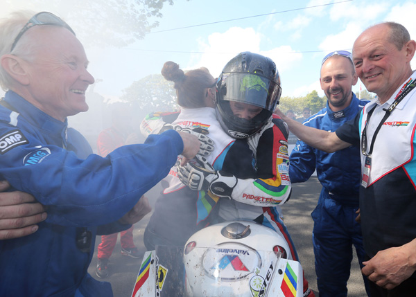 Bruce Anstey congratulated by his team, partner team manager Clive Padgett