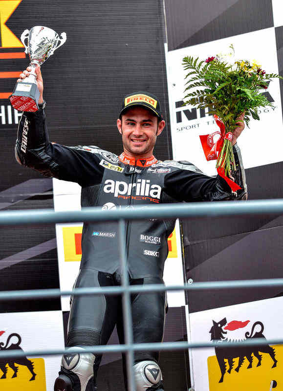 Leon Haslam on the podium, Aprilia WSBK