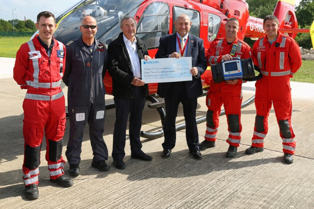 s Nick Mason makes cheque presentation to the Midlands Air Ambulance Charit