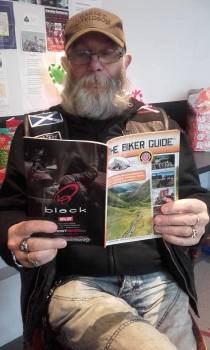 Jock reading THE BIKER GUIDE booklet at Bikers Cove, South Queensferry, Sco
