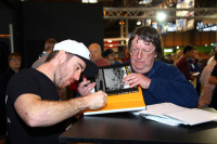Lee Johnston signing for a fan at Motorcycle Live