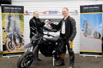 Fred Murphy from Redhill, Surrey, collecting the UKs first electric bike t