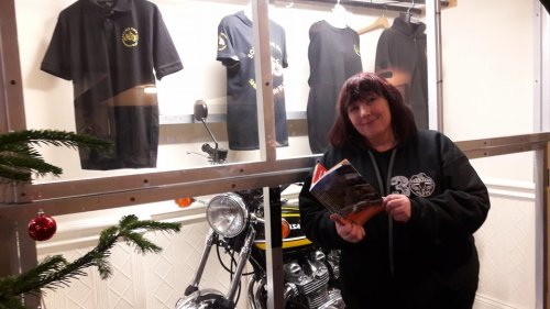 Karen at Squires with 6th edition booklet