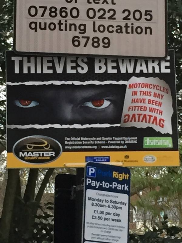 Close up of Thieves Beware sign in St Jamess Square London