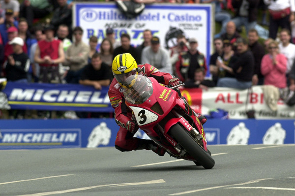 Joey Dunlop riding the SP1 Honda to victory in the F1 TT Race in 2000 on th