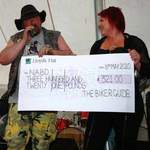 THE BIKER GUIDE donation to NABD. Photograph by Captain Smurf