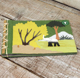 This is a photo album made from elephant poo - perfect for elephant lovers to store memories!