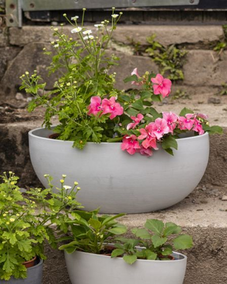 This Large White Oval Recycled Plant Pot is made from recycled materials