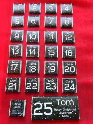 BLACK ADVENT (24 mini squares and 1 x 40g large bar in christmas organza bag)