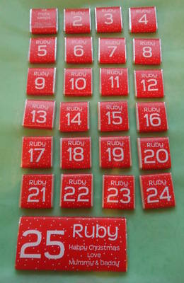 RED ADVENT (24 mini squares and 1 x 40g large bar) in christmas organza bag