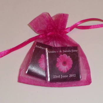 PINK GERBERA ON BLACK BACKGROUND - filled favour with 2 mini chocs
