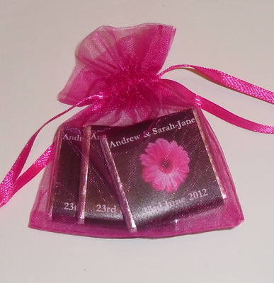 PINK GERBERA ON BLACK BACKGROUND - filled favour with 3 mini chocs