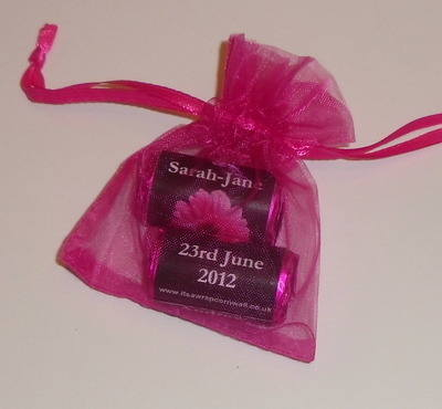 PINK GERBERA ON BLACK BACKGROUND - filled favour with 2 rolls love hearts