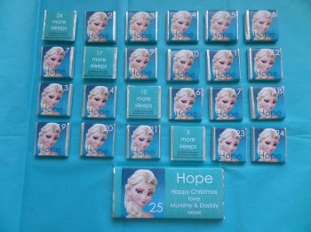 ELSA FROZEN ADVENT (24 mini squares and 1 x 40g large bar) in christmas organza bag