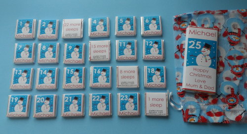 SMILEY SNOWMAN ADVENT (24 mini squares and 1 x 40g large bar) in christmas organza bag