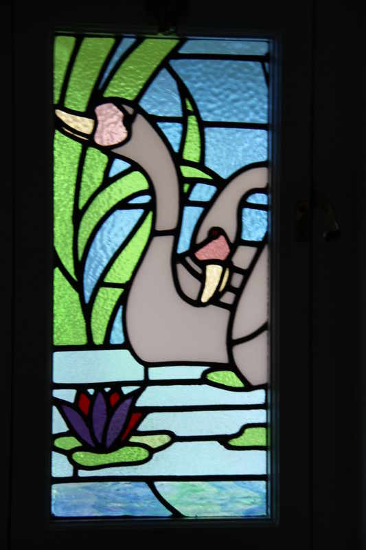 swan design stained glass panel