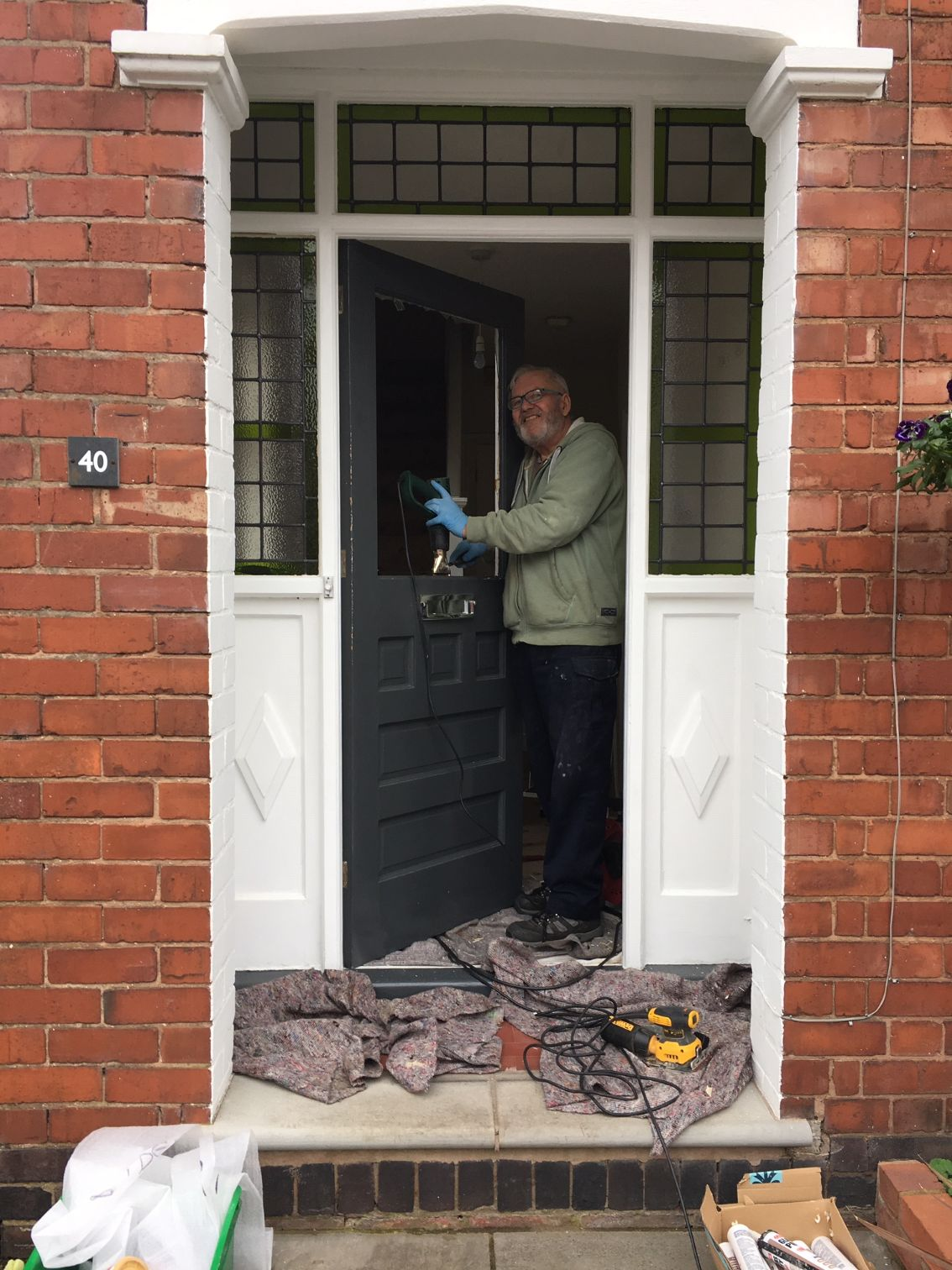 Peter from the Stained Glass Studio installing a client front door window