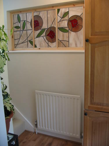 modern stained glass panel in home with pine frame