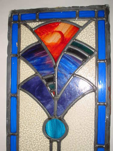 Blue and red fanned style stained glass