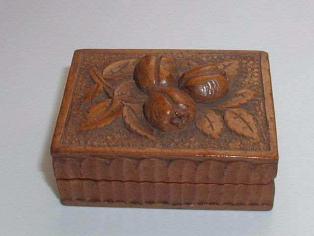 Antique carved miniature stamp box pomegranates black forest