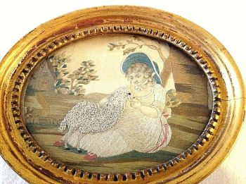 Antique Victorian needlework picture on silk in a gilded frame child with lamb