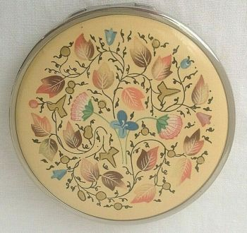 Vintage powder compact Coty enamelled top with raised gold accents beautiful