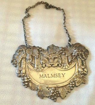 Vintage silver plate Welsh Whiskey label C1970s Malmsey Lion grape decoration