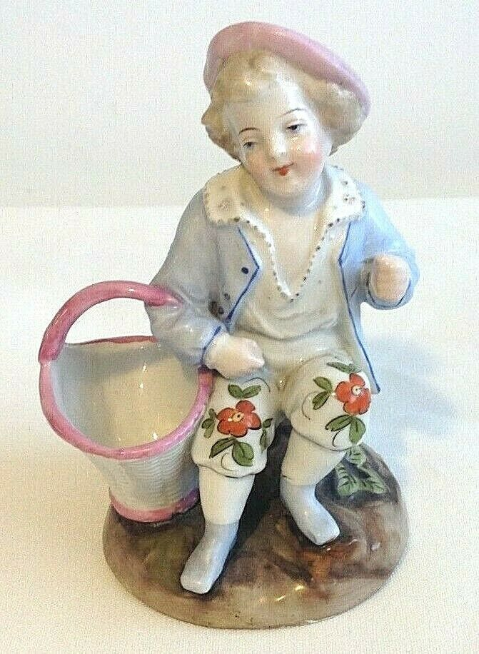Antique Victorian fairing or Staffordshire figure little girl with toy doll