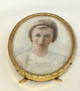 Antique portrait miniature early 20th century brass picture frame girl with bob
