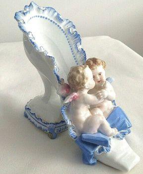 Antique Meissen style Victorian cherubs hugging in shoe ceramic figure