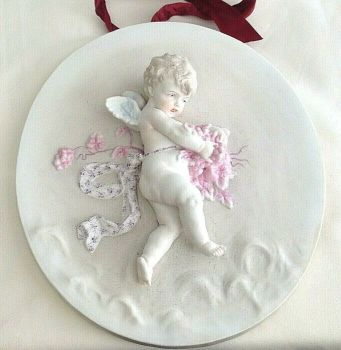 Antique bisque ceramic cherub plaque wall hanging possibly German