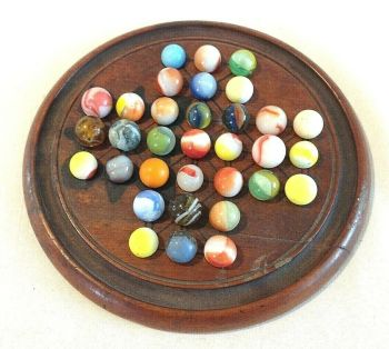 Antique Victorian wooden solitaire board with glass marbles