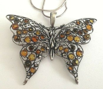 Vintage sterling silver butterfly pendent necklace set with baltic amber