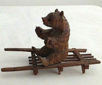 Antique carved wood Black Forest bear on sled